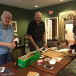 Jan, Dick and Traci organizing materials for safe viewing.