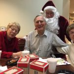 Santa is sneaking up on Beth, Bob and Judy