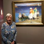 Gayle admires the picturesque artwork depicting a warm summer day at the ocean.